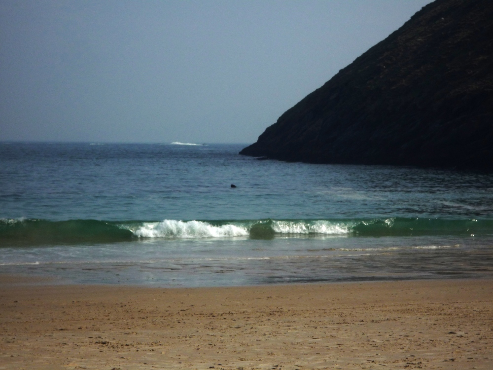 A late afternoon shot of Keem Bay in 2011 with the fin of a basking shark clearly visible